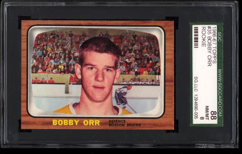 Image of: 1966 Topps Hockey Bobby Orr ROOKIE RC #35 SGC 8 NM-MT (PWCC)